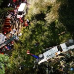 EDITORS NOTE GRAPHIC CONTENT - Coffins are lined up near the wreckage of a bus following a crash near Avellino, southern Italy, early Monday, July 29, 2013. A tour bus filled with Italians returning home after an excursion plunged off a highway into a ravine in southern Italy on Sunday night after it had smashed into several cars that were slowed by heavy traffic, killing at least 37 people, said police and rescuers. Flashing signs near Avellino, outside Naples, had warned of slowed traffic ahead along a stretch of the A16 autostrada, a major highway crossing southern Italy, before the crash occurred, said highway police and officials, speaking on state radio early Monday. They said the bus driver, for reasons not yet determined, appeared to have lost control of his vehicle. (AP Photo/Salvatore Laporta)